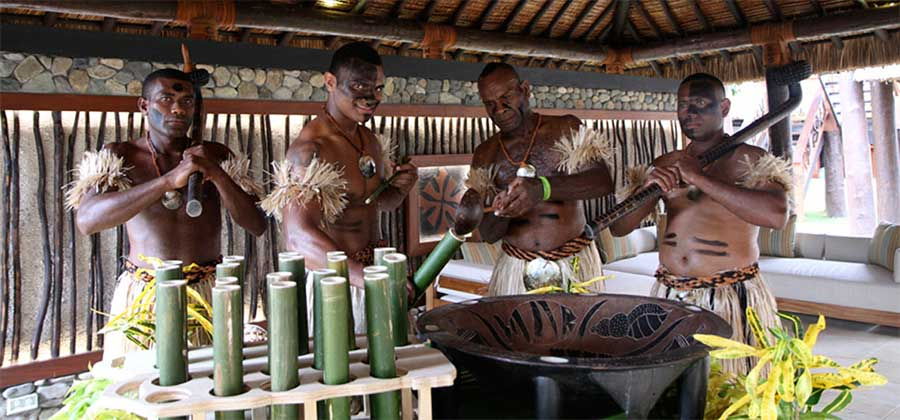 fijian men preparing kava